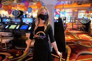 Courtney, a Rainbow Club Casino employee, wearing a mask and a Rainbow Club Casino shirt