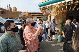 People gathered in front of Rainbow Club Casino to see the ribbon cutting for the reopening