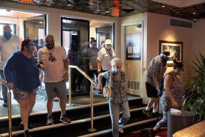 People walking into Rainbow Club Casino