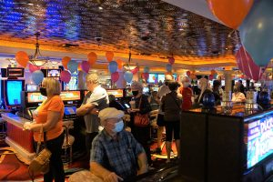 People enjoying their time at Rainbow Club Casino