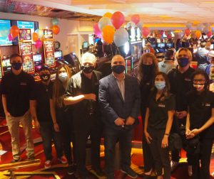 Tim Brooks, co-owner of Rainbow Club Casino, standing next to Success City Online's team