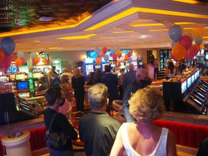 People standing as Ellie Smith sings Over the Rainbow for Rainbow Club Casino's grand reopening