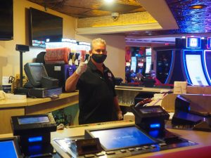 A bartender at Rainbow Club Casino giving a thumbs up